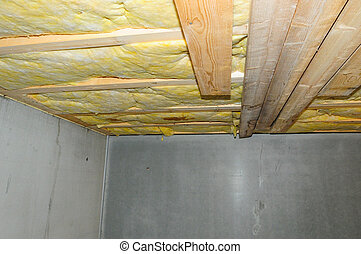 Wet faulty ceiling insulation in a basement.