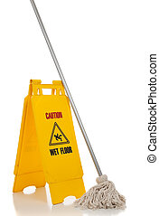 A wet floor sign and mop on a white background