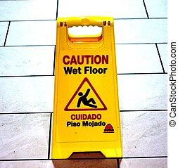 """WET FLOOR SIGN - A """"wet floor"""" sign with floor tiles in the..."""