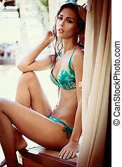 wet girl in bikini by the pool