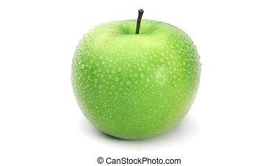 Wet green apple turning