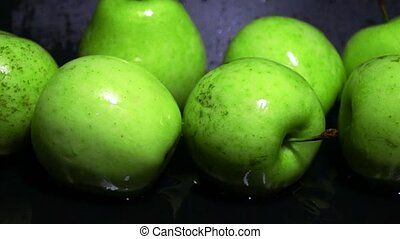 Wet green apples and water ripple super slow motion shot. Freshness concept