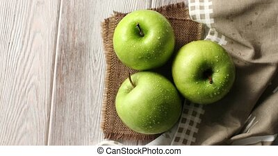 Wet green apples on canvas - From above shot of wet ripe...