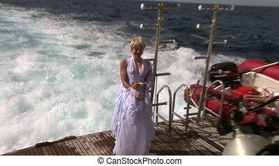 Wet model on ship near water in Red Sea.