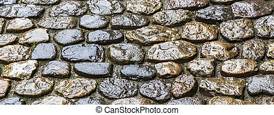 wet old historic cobble stone road