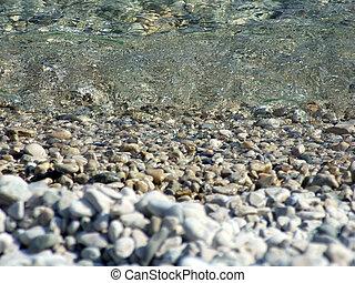 Wet pebble in waves of the Black Sea 3