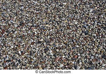 wet Pebbly beach stone background in Mediterranean sea beach, Rhodes, Greece