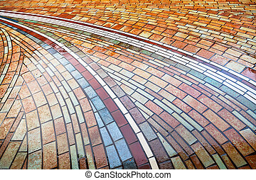 wet pied brick pavement in Bologna, Italy