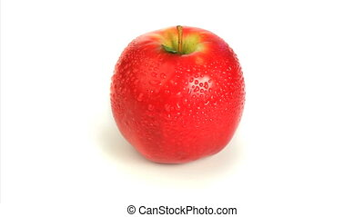 Wet red apple rotating