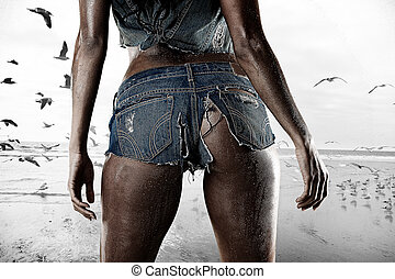 Wet ripped tiny denim booty shorts - Sexy woman standing on...
