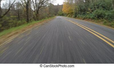 Wet Road Flies Behind on Blue Ridge - Rear view of driving...