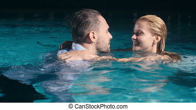 Wet Romance - Beautiful young couple in evening clothes...
