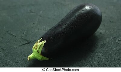 Wet single eggplant - Closeup of single ripe eggplant with...