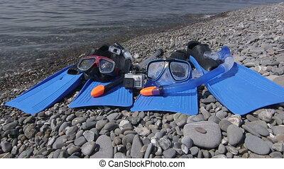waterproof action camera on selfie stick recording video...
