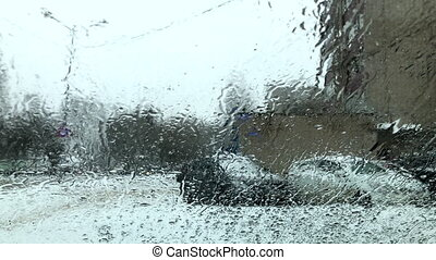 wet snow with rain falls on the glass slowly dripping winter bad weather