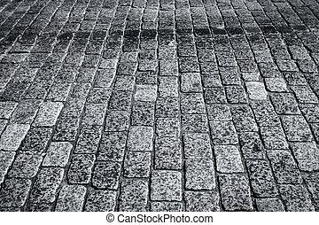 Wet stone paved avenue street roa