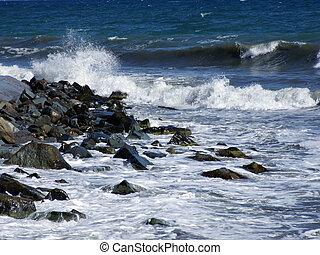 Wet stones in waves of the Black Sea