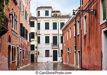 wet street in Venice city in rain