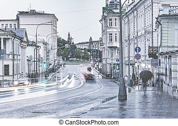 Wet street under the pouring rain by Kremlin.