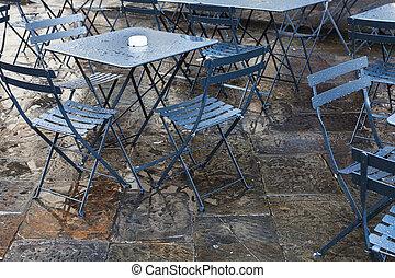 wet tables in street restaurant after autumn rain