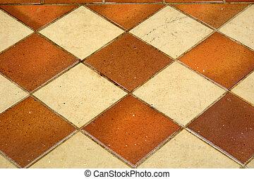 Wet Tiles - diamond pattern of outdoor tiles in the rain,