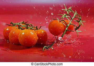 wet tomato - ripe tomato falling into water