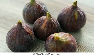 Wet washed whole figs on table - From above shot of composed...