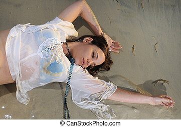 Wet woman on the sand