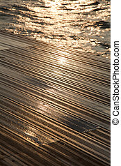 Wet Wooden Deck & Sea