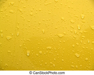 yellow textural background; macro of car body with raindrops