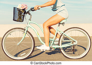 What a beautiful scenery! Smiling young couple riding on bicycle while man pointing away