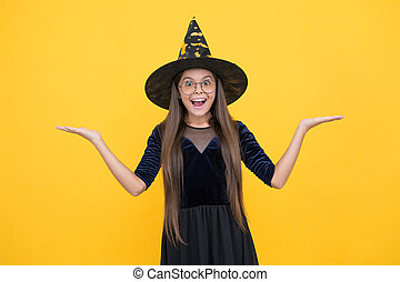 what a surprise. carnival costume party. trick or treat. celebrate the holidays. wizardry. halloween witch girl. happy childhood. teenage child in witch hat and glasses. cheerful kid create miracles