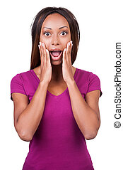 What a surprise! Surprised young African woman holding her head in hands while standing isolated on white