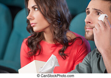 What a wonderful movie! Young couple watching movie at the cinema