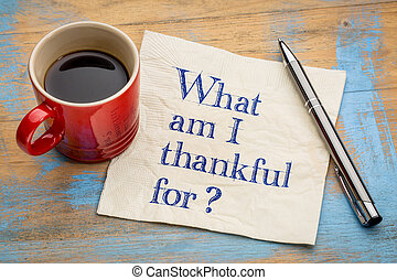 What am I thankful for? A question in handwriting on a...