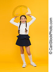 what angle you look. stem class. Math science. back to school. Mathematics education. Kid in uniform on yellow background. happy small school girl study geometry. student use protractor ruler
