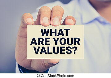 WHAT ARE YOUR VALUES? , message on the card shown by a man
