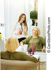 Nice skillful woman talking to her client