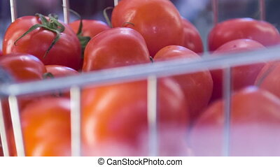 Tasty look. Selective focus on heap of red ripe tomatoes stimulating the appetite