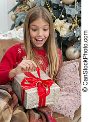 What is inside. The morning before Xmas. Little girl. Happy new year. Winter. xmas online shopping. Family holiday. Christmas tree and presents. Child enjoy the holiday