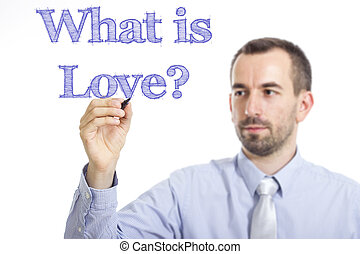 What is Love? - Young businessman writing blue text on transparent surface