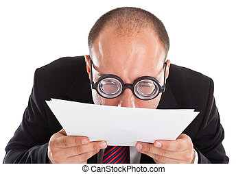 What is this? - A businessman wearing thick, circle glasses ...