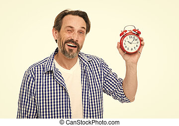 What time is it. Bearded senior man with mechanical clock in...