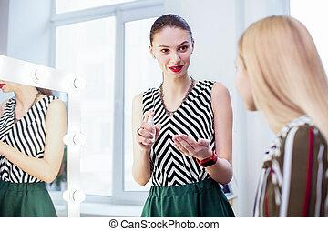 Joyful nice woman speaking with her client