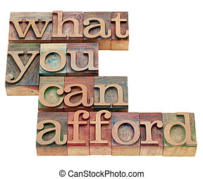what you can afford - isolated phrase in vintage wood letterpress printing blocks