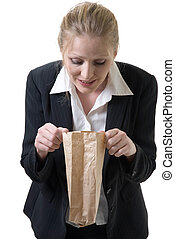 Whats for lunch - woman at work peeking into lunch bag