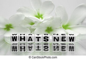 Whats new text with green flowers