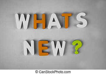 Whats new ? word written with different colored letter blocks on a white background