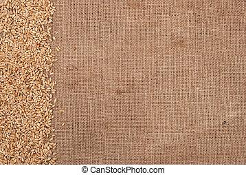 Wheat border on burlap background