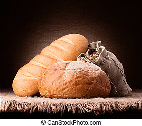 Wheat bread and flour sack still life